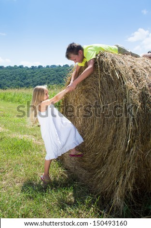 A child reaches out to a friend - stock photo