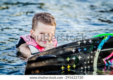 A child riding in the Wakeboarding - stock photo