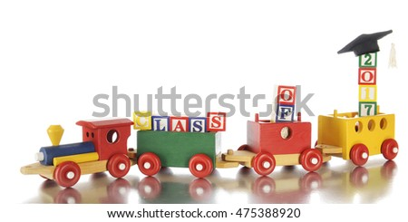 "A child's colorful wooden train pulling alphabet blocks arranged to say, ""Class of 2017"", with its reflection below.   The year is topped with a black mortarboard.  Isolated on white."