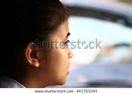 A child's eyes Asian love. Portrait of a cute Asian child girl and looking aside in-Thailand. A child's eyes Asian love. Portrait of a cute Asian child girl - stock photo