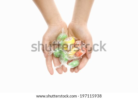 A Child'S Hand Holding A Candy - stock photo