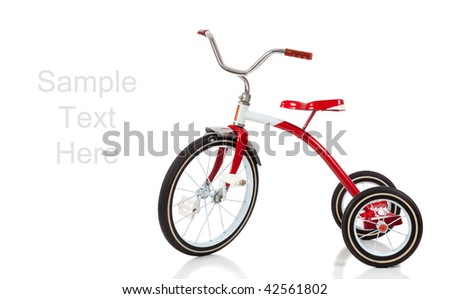 A child's red tricycle on a white background with copy space - stock photo