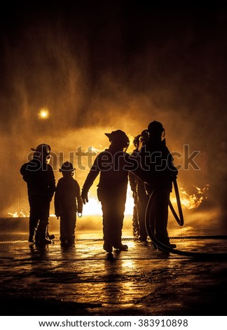 A child watching firebeing put out - stock photo