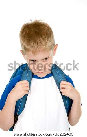 A child with a backpack is unhappy about returning to school. - stock photo
