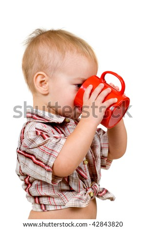 A child with a cup - stock photo