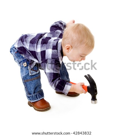 A child with a hammer - stock photo