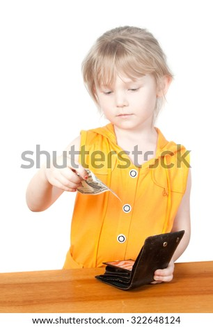 A child with a purse and dollar bills. Isolated on white background - stock photo