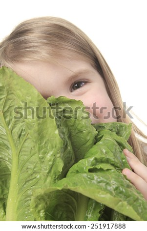 A child with a saled in front of a white background. - stock photo