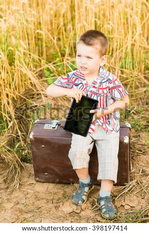a child with a tablet in nature