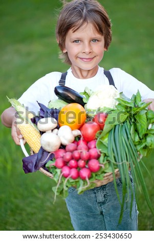 A child with vegetables - stock photo