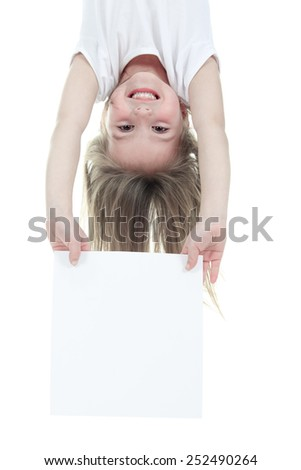 A children girl holding a white card over a white background. - stock photo