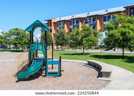 A children playground equipment in the apartment complex. - stock photo