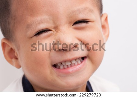 A Chinese boy closeup isolated on white background. - stock photo