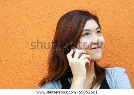 A Chinese girl who is talking in phone - stock photo