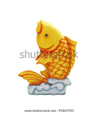 A Chinese New Year feng shui ornament of a golden carp, isolated against white. - stock photo