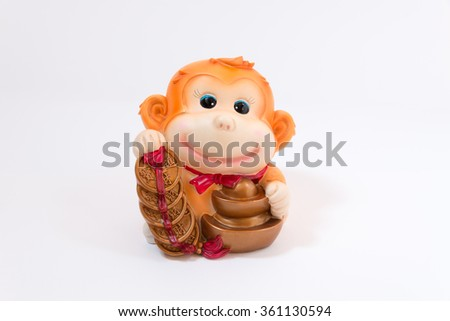 A chinese new year's gold figure represent a year of monkey with word represent long live, prosper and good luck - stock photo
