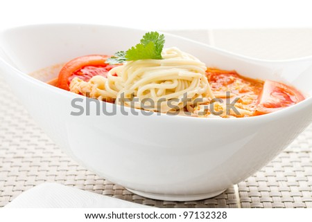 A Chinese noodles, sauced noodles, tomatoes and eggs