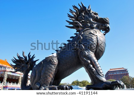 A Chinese unicorns in an imperial park, which stands for power and authority. This animal is fictional in fairy tales like Chinese dragon. - stock photo