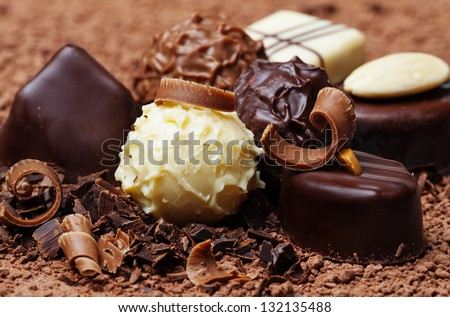 a chocolate background with pralines - stock photo