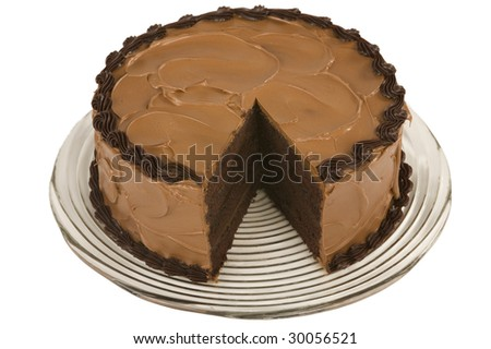 A Chocolate Cake with a slice missing - stock photo