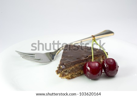A chocolate cake with cherry