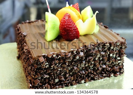 A Chocolate cake with fresh fruit decoration - stock photo