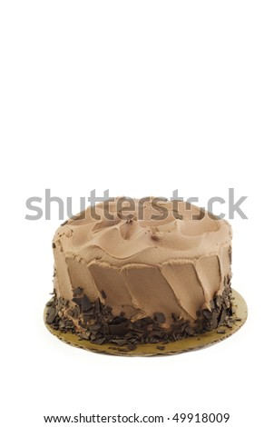 A chocolate fudge layer cake isolated on a vertical white background with copy space - stock photo