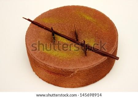 A Chocolate Mousse Cake on white background - stock photo