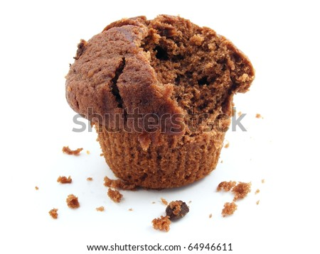A chocolate muffin on a white background with a bite taken out of it. - stock photo