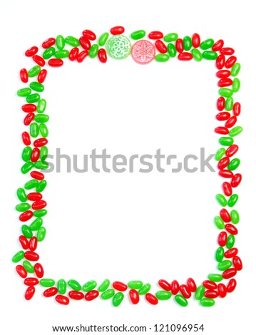 A Christmas page frame made of red and green jelly beans with hard candy accents
