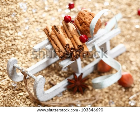 A Christmas sledge full of herbs and nuts on a festive background. Whole series in my Portfolio