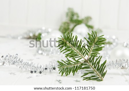 a christmas still life with a fir twig - stock photo