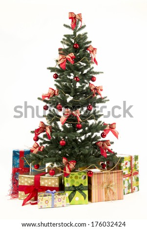 A Christmas tree surrounded by packages with bows.