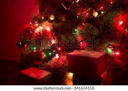 A christmas tree with christmas tree lights in the dark. - stock photo