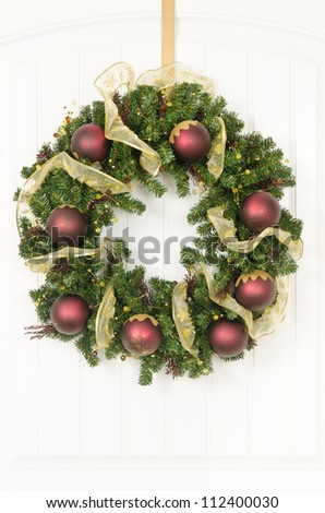 A Christmas wreath of burgundy and gold - stock photo