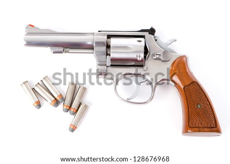 A chrome .38 police special revolver handgun with six hollow point bullets on a white background. - stock photo