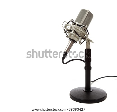 A chrome,  vintage ribbon microphone on  a mic stand on a white background