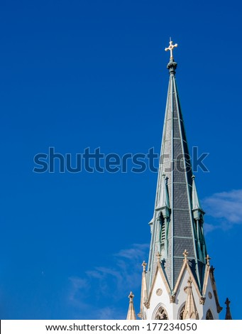 A church spire against an almost perfectly blue sky. - stock photo