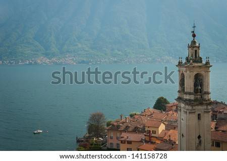 A church tower on the banks of Lake Como in Italy - stock photo
