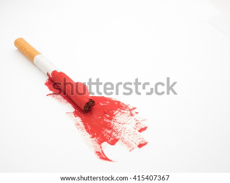 A cigarette painted with red paint over a white background