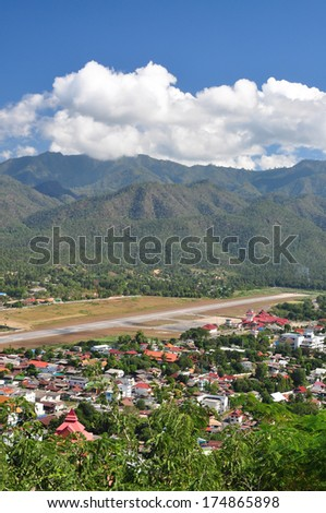 a city lied between mountain - stock photo