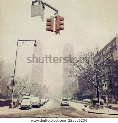 A city street during winter time with snow on the ground. - stock photo