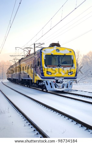 a city train on snow covered tracks - stock photo