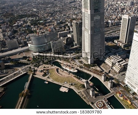 A city with many skyscrapers on the waterfront. - stock photo