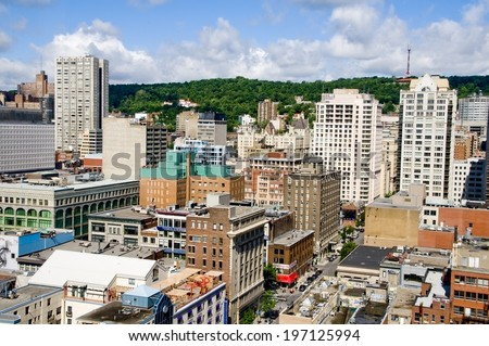 A city with various sized buildings all close together. - stock photo