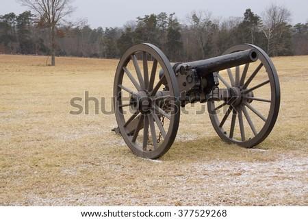 A Civil War cannon in a cold field                          - stock photo
