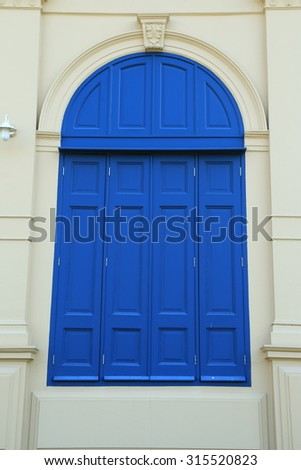 A classic blue large window at Thailand's Grand Palace, Bangkok, Thaialnd