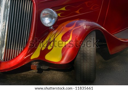 A classic bright red hotrod with flames - stock photo