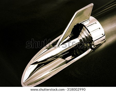 A classic chrome hood ornament from a 1950's era American car. - stock photo