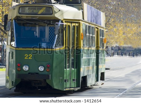 A classic green and gold Melbourne tram. - stock photo